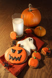 Halloween cookies with a glass of milk royalty free stock image