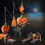 Halloween cookies hanging on a tree in the night sky Stock Photo