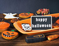 Halloween cookies and holiday greetings Royalty Free Stock Photography