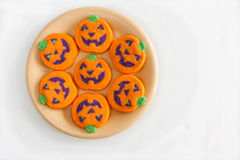 Halloween Cookies. A plate of jack-o'-lantern cookies Royalty Free Stock Photography