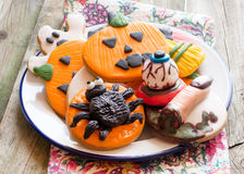 Halloween cookies on plate standing on towel Stock Photo