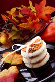 Halloween cookies with pumpkins in background Stock Photos