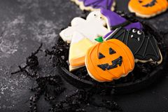 Halloween cookies decorated with royal icing stock images