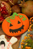 Halloween cookies and yellow berries Royalty Free Stock Photos