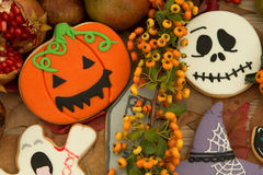 Halloween cookies and yellow berries Royalty Free Stock Images