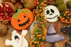 Halloween cookies and yellow berries Stock Photography