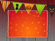 Halloween background with bunting and panel on wood. Halloween Copy Space Area with Stars and Moon Over Wooden Background with Bunting Royalty Free Stock Photo