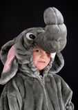 Halloween costume. Boy dressed up in elephant Halloween costume on black background Stock Photos