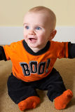 Halloween Costume. Boy scares the camera with shirt that says boo, in halloween colors of orange and black stock image