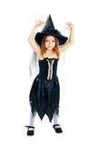 Halloween costume. Beautiful cute little girl in witch halloween costume smiling to the camera isolated over white Stock Photo