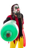 Halloween costume of a creepy clown with balloons, isolated on w Stock Images