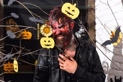 Halloween costume party concept. Demon with horns and evil smile. Halloween costume party concept. Demon with horns, evil smile and dried blood on hair. Man stock images