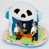 Halloween costumes. Kids in pirate halloween costumes play on shrunken down toy island stock image
