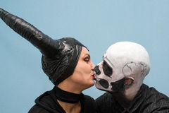 Halloween couple in traditional costumes and makeup Stock Photos