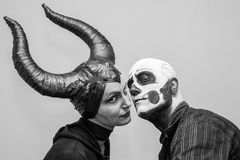Halloween couple in traditional costumes and makeup Royalty Free Stock Photo