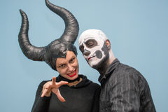 Halloween couple in traditional costumes and makeup Stock Image