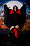 Halloween couple vampire. Halloween couple horror character vampire. Studio, painted themed background Royalty Free Stock Photos