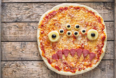 Halloween creative scary food monster zombie face with eyes pizza snack royalty free stock image