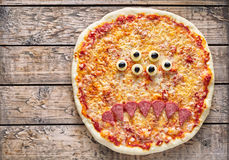 Halloween creative scary food monster zombie face pizza snack with mozzarella Stock Image