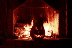 Halloween creepy pumpkin fireplace with fire, isolated in the re Royalty Free Stock Images