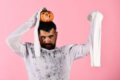 Halloween, culture and religion concept. Halloween character in ghost costume. Halloween, culture and religion concept. Halloween character in white long sleeved stock photos