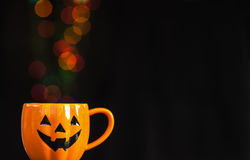 Halloween cup with bokey background. Halloween cup with colorful bokeh for background use Stock Photo