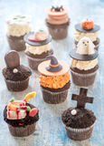 Halloween cup cakes. Funny cup cakes as Halloween decoration,selective focus Royalty Free Stock Images