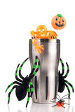 Halloween cup with spiders, candy, lollipop Royalty Free Stock Photo