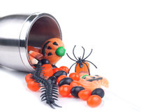 Halloween cup spilling candies Stock Photos