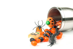 Halloween cup spilling candy Stock Image