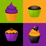 Halloween cupcake background. Vibrant halloween cupcakes and brighly coloured square backgrounds Royalty Free Stock Photography