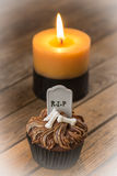 Halloween cupcake and a burning candle with vignetting effect Stock Photo
