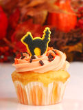 Halloween cupcake with fall foliage Royalty Free Stock Photos