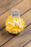 Halloween cupcake with gravestone cake topper top view Royalty Free Stock Photography