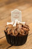 Halloween cupcake on an old rustic wooden background Stock Images