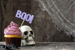 Halloween cupcake and pumpkin on rustic wooden background Stock Photos