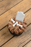 Halloween cupcake on a rustic wooden table top view Stock Photos
