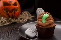 Halloween cupcake with tombstone. Stock Images