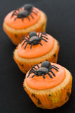 Halloween cupcakes. Three halloween cupcakes in a row Royalty Free Stock Images