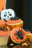 Halloween cupcakes. Cupcakes decorated with orange frosting and spiders Stock Photography