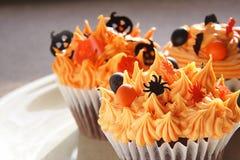 Halloween cupcakes. Plate of three decorated halloween cupcakes stock photo