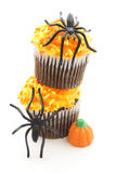Halloween cupcakes. Two stacked Halloween cupcakes with spiders over white Stock Photo