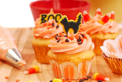 Halloween cupcakes being frosted royalty free stock image