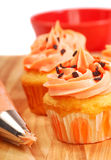 Halloween cupcakes being frosted. Delicious Halloween cupcakes being frosted and decorated Stock Photography