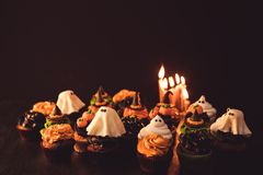 Halloween cupcakes and burning candles Royalty Free Stock Images