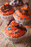 Halloween cupcakes with chocolate bat on a table close-up. verti Stock Image