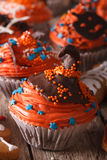 Halloween cupcakes with chocolate witches hat close-up vertical Royalty Free Stock Photography