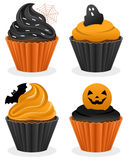 Halloween Cupcakes Collection. Set of four Halloween sweet cupcakes, isolated on white background. Eps file available Stock Photos