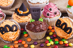 Halloween cupcakes with colored decorations Royalty Free Stock Image