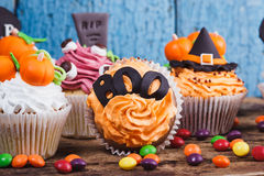 Halloween cupcakes with colored decorations Royalty Free Stock Photo